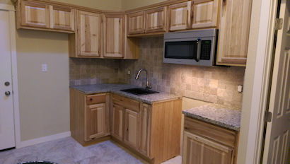 New cabinets, granite and tile backsplash.